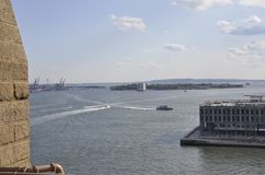 Governors Island view from Brooklyn Bridge over East River from New York City in United States stock photo