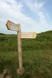 Gower Coast signs in welsh. Sign in English and Welsh showing the way to the beach Stock Photography