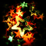 Gowing star background. Illustration of a colorful background with stars and bokeh - blur effect stock illustration