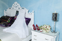 Gown, rings, shoes and bouquet for wedding Stock Image