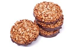 Gozinaki from sunflower seeds on chocolate Royalty Free Stock Image
