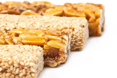Gozinaki - traditional Georgian confection. Honey bars with peanuts and sesame seeds Royalty Free Stock Images