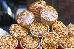 Gozinaky. Candied roasted nuts. Honey bars with peanuts, sesame and sunflower seeds, close-up. stock photo