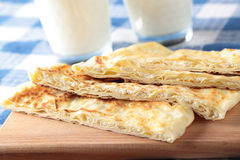 Gozleme. Slices of gozleme with cheese on a cutting board Royalty Free Stock Photo