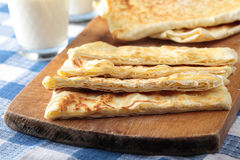 Gozleme. Slices of gozleme with cheese on a cutting board Royalty Free Stock Photography