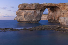 Gozo Azure Window Long Exposure. The Azure Window is a natural stone arch in the island of Gozo in Malta and features a table-like rock over the sea Royalty Free Stock Photography