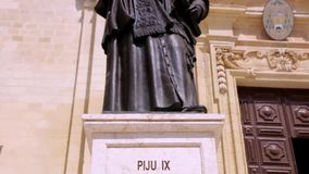 Gozo Cathedral Pope Pius IX statue stock footage