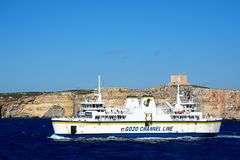 Gozo Channel Line Ferry passing Comino, Malta. Ta Pinu Gozo Channel Line ferry with views towards Comino to the rear during the Springtime, Malta, Europe Royalty Free Stock Images