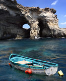 Gozo cliff face. And a fishing boat royalty free stock photography