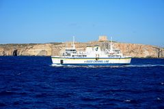 Gozo ferry with Comino to the rear. Ta Pinu Gozo Channel Line ferry with views towards Comino to the rear during the Springtime, Malta, Europe Royalty Free Stock Photos