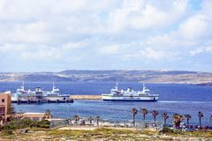 Ferries at Paradise Bay, Malta. Gozo ferry in the ferry terminal with views towards Gozo, Paradise Bay, Malta, Europe Stock Photos