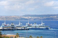 Ferry terminal at Paradise Bay, Malta. Gozo ferry in the ferry terminal with views towards Gozo, Paradise Bay, Malta, Europe Stock Images
