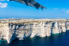 Gozo island from above, under the wing of a small plane. Aerial view of Gozo, Malta. The dome of Rotunda of Xewkija. stock photos