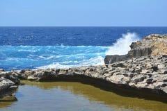 Gozo Island - azure heart seas. Gozo Island - stormy seas near the Azure Window. Azure blue sea with wild waves Stock Image