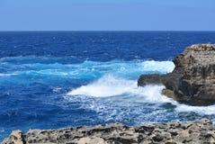 Gozo Island - azure seas. Gozo Island - stormy seas near the Azure Window. Azure blue sea with wild waves Stock Image