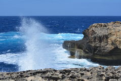 Gozo Island - azure seas. Gozo Island - stormy seas near the Azure Window. Azure blue sea with wild waves Stock Photos