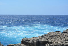 Gozo Island - azure seas. Gozo Island - stormy seas near the Azure Window. Azure blue sea with wild waves Royalty Free Stock Image
