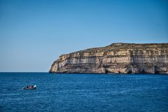 Gozo Island and Blue Sky. Photo of the cliffs of Malta and the boat Stock Images