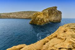 Gozo island coastline Malta. Big rock in the Mediterranean sea at the entrance to the Dwajra Bay, on the coast of Gozo, Malta Royalty Free Stock Photography
