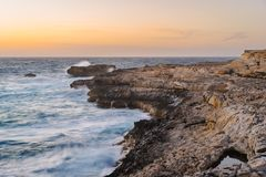 Gozo Island coastline at sunset, Malta. Gozo Island coastline during the spring storm. Dwejra, Maltese archipelago Royalty Free Stock Photography