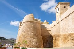Gozo Island: Impressive walls and towers of Citadel in Rabat, Malta. Gozo Island, Malta: Landscape impressive walls and towers of the Citadel at the hill above Royalty Free Stock Photos