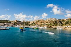 Gozo island landscape of Malta. Sandstone cityscape of Gozo island taken from ferry. Historical architecture of Malta Royalty Free Stock Image