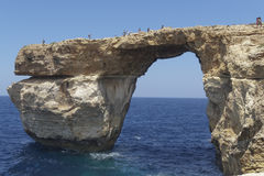 Gozo Island, Malta Azure window tourists on the cliff. Azureus window was in danger of collapsing. It finally collapsed on March 08 2017 after being hit by Stock Image