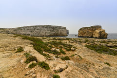 Gozo island, Malta. Fungus Rock, known as the General's Rock, is a 60 meters high islet at the entrance to the Dwajra Bay, on the coast of Gozo, Malta Stock Photo