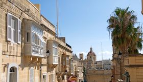 Gozo Island: Unique landscape of Rabat, Malta. Gozo Island, Malta: Scenic landscape of Rabat, with typical, Maltese architecture details. There are white, wooden Royalty Free Stock Photo