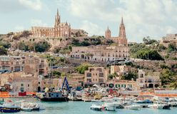 Free Gozo Island Port View With Fishing Boats And Old Churches On A Hill Stock Photography - 162072742