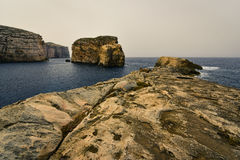 Gozo island cliffs landscape Malta. Fungus Rock, known as the General's Rock, is a 60 meters high islet at the entrance to the Dwajra Bay, on the coast of Gozo Royalty Free Stock Photo