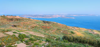 Gozo island terrain. View towards Malta and Comino. Gozo island terrain from the hill top. View towards Malta and Comino across the Pass Royalty Free Stock Images