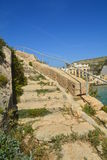 Gozo Island - Xlendi Bay. The stone stairs Royalty Free Stock Image