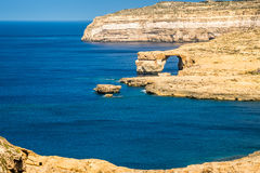 Gozo, Malta - The Azure Window and Dwejra bay. On a beautiful summer day with clear blue sky Stock Photography