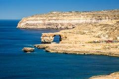 Gozo, Malta - The Azure Window and Dwejra bay on a summer day. Gozo, Malta - The Azure Window and Dwejra bay on a beautiful summer day with clear blue sky Royalty Free Stock Photography
