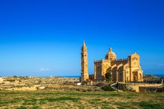 Gozo, Malta - The Basilica of the National Shrine of the Blessed. Virgin of Ta` Pinu early at the morning with clear blue sky on a summer day Royalty Free Stock Photography