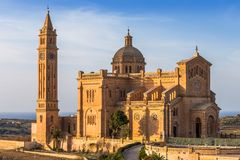 Gozo, Malta - The Basilica of the National Shrine of the Blessed. Virgin of Ta` Pinu at sunset with clear blue sky on a summer day Royalty Free Stock Photos