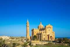 Gozo, Malta - The Basilica of the National Shrine of the Blessed Virgin of Ta` Pinu. Early at the morning with clear blue sky on a summer day Royalty Free Stock Photo