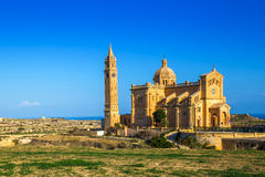 Gozo, Malta - The Basilica of Ta` Pinu at sunrise. Gozo, Malta - The Basilica of the National Shrine of the Blessed Virgin of Ta` Pinu early at the morning with Stock Photography