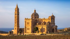 Gozo, Malta - The Basilica of Ta` Pinu at sunset with clear blue sky in the morning Stock Photo