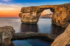 Gozo, Malta - The beautiful Azure Window, a natural arch and fam. Ous landmark on the island of Gozo at sunset Royalty Free Stock Photo