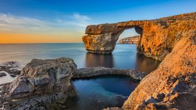 Gozo, Malta - The beautiful Azure Window, a natural arch and fam. Ous landmark on the island of Gozo at sunset Stock Photography