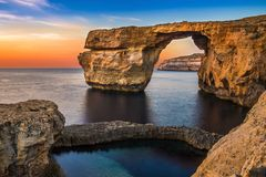 Gozo, Malta - The beautiful Azure Window, a natural arch. And famous landmark on the island of Gozo at sunset Stock Images