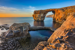 Gozo, Malta - The beautiful Azure Window at sunset. Gozo, Malta - The beautiful Azure Window, a natural arch and famous landmark on the island of Gozo at sunset Stock Photos
