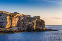 Gozo, Malta - The famous Fungus rock on the island of Gozo at Dw. Ejra bay at sunset Stock Photos