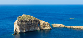 Gozo, Malta - The famous Fungus Rock on the island of Gozo on a hot summer day. Gozo, Malta - The famous Fungus Rock on the island of Gozo on a beautiful hot Royalty Free Stock Photography