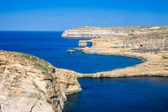 Gozo, Malta - The Fungus Rock and the Azure Window at Dwejra bay. On a beautiful summer day with clear blue sky sea water Stock Photography