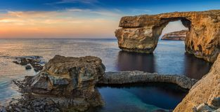 Gozo, Malta - Panoramic view of the beautiful Azure Window, a na. Tural arch and famous landmark on the island of Gozo at sunset Royalty Free Stock Photos