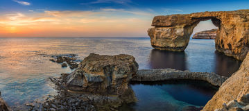 Gozo, Malta - Panoramic view of the beautiful Azure Window. A natural arch and famous landmark on the island of Gozo at sunset Royalty Free Stock Photography