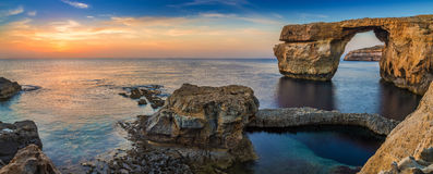 Gozo, Malta - Panoramic view of the beautiful Azure Window. A natural arch and famous landmark on the island of Gozo at sunset Royalty Free Stock Images